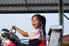 Little asian pretty girl enjoy riding. Royalty Free Stock Photos