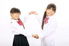 Little asian schoolgirls Stock Images