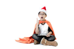 Little asian smile boy with santa hat. Acting think about that , isolated on white background Royalty Free Stock Image