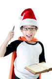 Little asian smile boy with santa hat. Acting think about that , isolated on white background Royalty Free Stock Photo