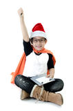 Little asian smile boy with santa hat. Little asiancute boy with santa hat playing supper hero sign isolated on white background Royalty Free Stock Photo