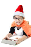 Little asian smile boy with santa hat. Playing tablet isolated on white background Royalty Free Stock Image