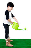 Little Asian smile child with watering pot Stock Photography