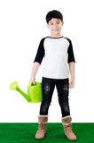 Little Asian smile child with watering pot.  Royalty Free Stock Photo