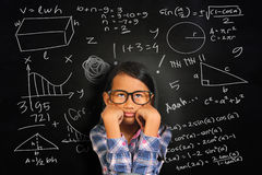 Little Asian Student Girl Getting Sick of Math royalty free stock photography