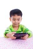 Little asian (thai) boy using digital tablet at desk Stock Photo