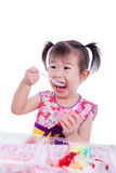 Little asian (thai) girl enjoy eating her birthday cake Royalty Free Stock Image