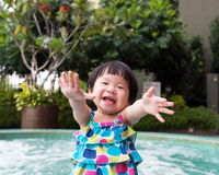 Little Asian toddler at the pool Stock Image