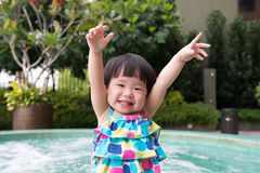 Little Asian toddler at the pool Stock Images