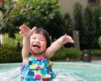 Little Asian toddler at the pool Royalty Free Stock Image