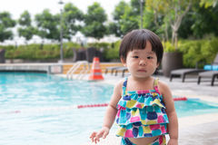 Little Asian toddler at the pool Stock Photos