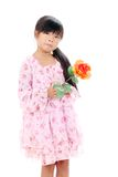Little asiatisk flicka som rymmer en rose Royaltyfri Fotografi