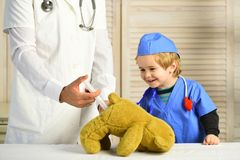Little Assistant Makes Injection To Teddy Bears. Royalty Free Stock Photography