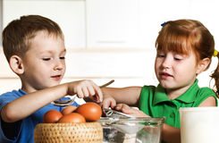 Little assistants on kitchen Stock Photography