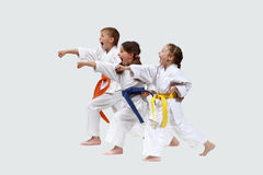 Little athletes in karategi are hitting punches Stock Images