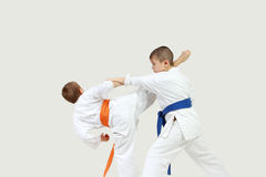 Little athletes perform paired exercises karate Royalty Free Stock Photos