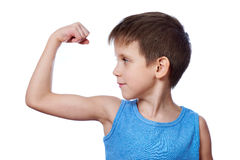 Little athletic boy looking at the biceps muscle isolated. White Stock Photo