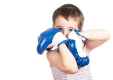 Little awkward boxer. Little boy in tank top boxing isolated on white Stock Photos