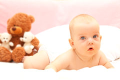 Little baby. Little beauty baby girl with a teddy bear Stock Photos