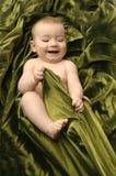 Little baby. Smilling little baby on green blanket Stock Image