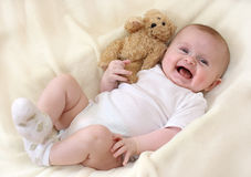Little baby. With teddy bear stock image