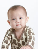 Little baby. With a very funny expression Royalty Free Stock Image