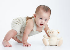 Little baby. Play alone, a studio shot Stock Image