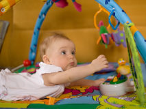 Little baby. Play in developmental toy Stock Photo