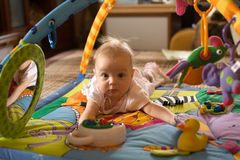 Little baby. Play in developmental toy Royalty Free Stock Photo