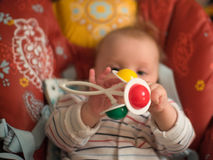 Little baby. Play with rattle Royalty Free Stock Photography