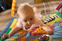 Little baby. Play in developmental toy Stock Photos