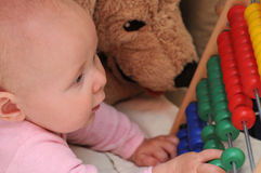 Little Baby with abacus Stock Photo