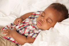 Little Baby African American Boy Sleeping Stock Photo