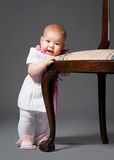 Little baby with armchair Stock Images