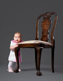 Little baby with armchair Royalty Free Stock Photo
