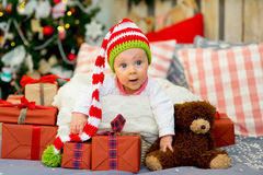 Little baby in the arms of Santa Claus Royalty Free Stock Images