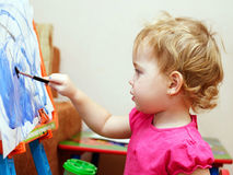 Little baby artist is painting Royalty Free Stock Photo