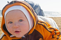 Little baby on the autumn beach Royalty Free Stock Images