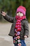 Little baby in an autumn park. Nice little baby in an autumn park Stock Photo