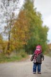 Little baby in an autumn park. Nice little baby in an autumn park Stock Photography