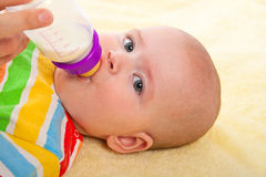 Little baby with baby's bottle Stock Photo