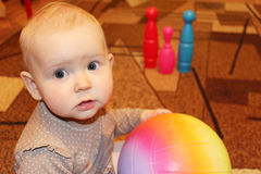 Little baby with a ball in perplexity Royalty Free Stock Images