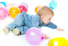 Little baby in balloons Stock Images