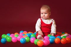 Little baby with balls Royalty Free Stock Image