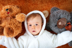 Little baby in bear costume with plush toys Royalty Free Stock Photo