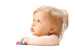 Little baby behind the white tablet Royalty Free Stock Photo