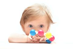 Little baby behind a white tablet Royalty Free Stock Photos