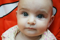 Little baby with big blue eyes Stock Image