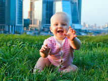 Little baby in a big city Stock Photography