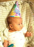 A little baby on birthday party. A little baby is on somebady's birthday party Stock Photo